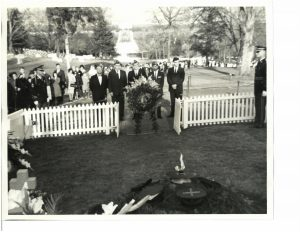 Photo of Dr. Garcia laying wreath at Kennedy's Grave