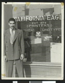 Ca. 1941. John Kinloch standing in front of the California Eagle editorial offices.