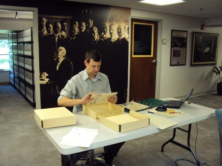 History Associates archivist working in the Farm Credit Archives