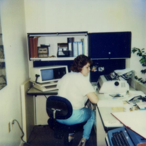 An HAI employee at her desk in 1984. Even back then, technology informed the way we did business