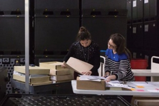 Collections managers prepare museum objects to be packed and relocated.